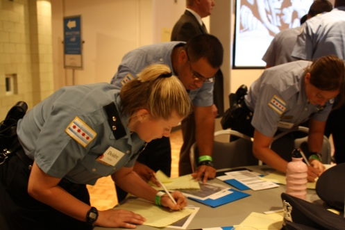 Police recruits write down their impressions at Thursday's training session.