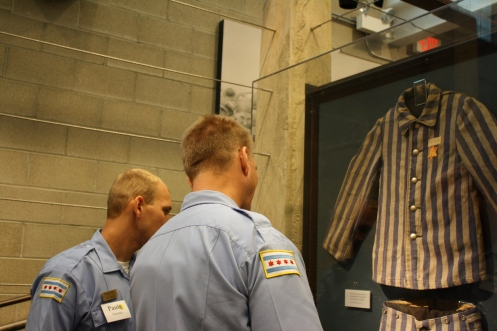 Mieszala and a colleague look at an exhibit of a concentration camp uniform at the Skokie Holocaust Museum.