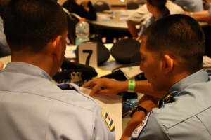 Police officers-in-training look over material at the workshop.